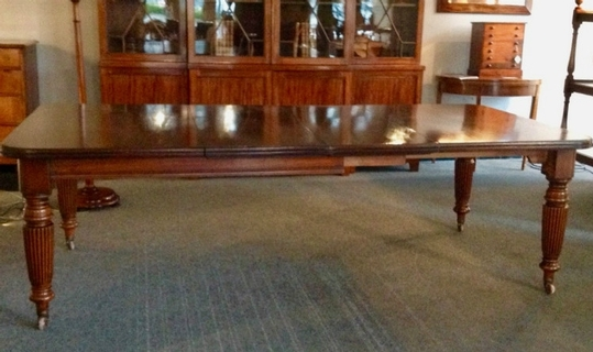A 19th C mahogany extending dining table having two leaves