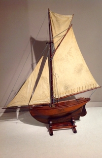 An 19th Century English gaff-rigged Pond Yacht with trunk cabin, brass fittings and a set of four stitched linen sails