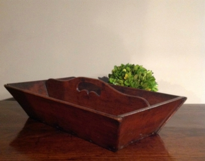 An Early 18th Century oak tray with a deep patina.