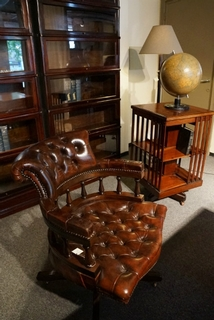 A early 20th Century English Brown Revolving Desk Chair on the original castors  and having a very comfortable reclining action. .