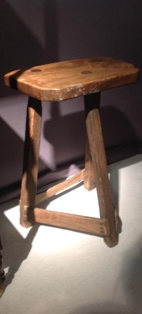 An 19 th Century primitive stool having a very nice patina