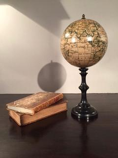 An English 20 th Century Small Terresterial Globe having a ebonised stand
