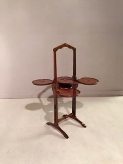 An English Mahogany Monoplane Cake Stand signed.