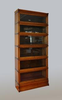 An English Oak Globe Wernicke Bookcase Having 6 Sections.